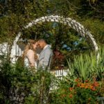 bride and groom under an arch photo