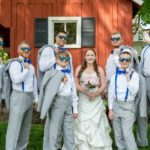 Bride with groomsmen photo